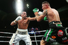Even Danny Green (right) was mystified how one judge scored him a 98-90 winner over Anthony Mundine in what was a close fight. Photo / Getty Images