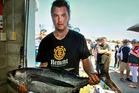 Robbie Wigmore with the winning catch a 18.2kg albacore tuna which he caught off his boat yesterday during the Breakers Restaurants MegaFish 2017 competition. Photo / Warren Buckland