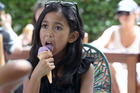 COOLING OFF: Fatihah Rashid, 8, of Hastings enjoying a Rush Munro's ice cream yesterday. Photo Duncan Brown