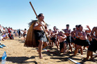 Mukai Hura leads a haka performed by hundreds of paddlers at Te Tii Beach. PHOTO/JOHN STONE