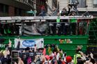 New England Patriots quarterbacks Tom Brady and Jimmy Garoppolo wave to fans during a parade. Photo / AP