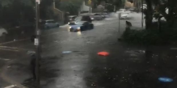 A car stuck in the floods in Redfern. Photo / Twitter