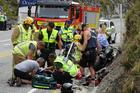 AJ Hackett Bungy staff help paramedics and fire volunteers after Sunday's crash. Photo / Guy Williams