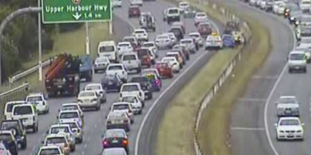 The crash is blocking the right lane - northbound - after the Tristram Ave on-ramp. Photo / NZTA