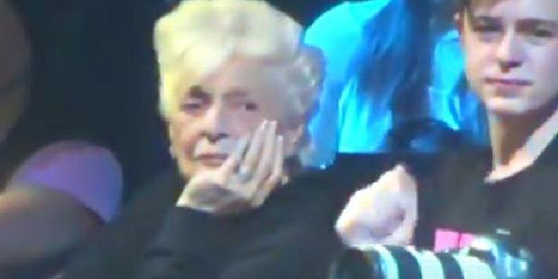Ariana Grande's grandmother looks less than impressed. Photo / YouTube