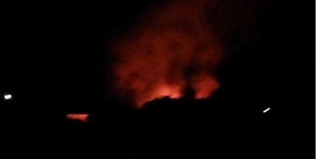 The night-time scene of a fierce blaze that extensively damaged  a storage workshop at the Airborne Honey Farm in Leeston, Photo / Facebook