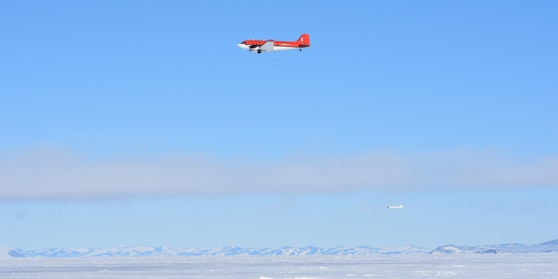 Towed below a DC3 aircraft, the state-of-the-art EM-bird flies 15 metres above Antarctic sea ice. Photo / P Langhorne.