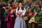 Footage from the iconic film shows Dorothy meeting the Munchkins in Oz
