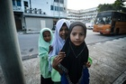 Girls at the Rohingya Education Centre in Penang. Photo / Getty Images