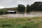 Cyndi Friend's property in Levin was ravaged by a raging torrent of water after a stopbank burst during the early hours of Friday morning, leaving them homeless.