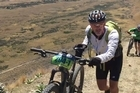 Michael Brown and Herald videographer Greg Bowker finish the epic seven day mountain bike challenge
