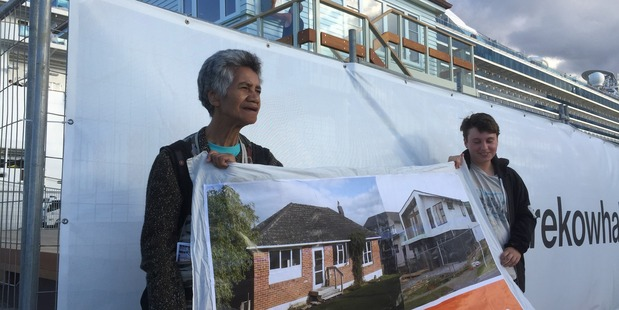 Glen Innes state house tenant Niki Rauti protests outside the opening of the $1.5 million art work dubbed: The Lighthouse. Photo / Simon Collins