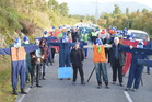 Twenty-nine figures stood in silence on the Pike River Mine access road this morning in an emotional protest aimed at preventing the permanent sealing of the mine portal. Photo / Greymouth Star