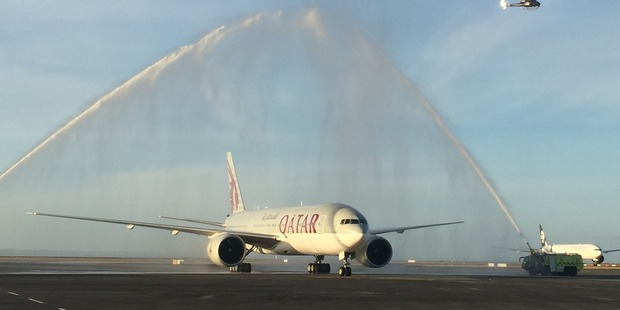 Loading Qatar's 777 gets a traditional water canon welcome at Auckland. Photo / Grant Bradley