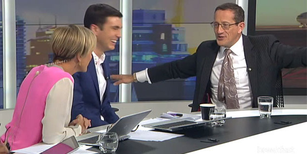 Richard Quest pretends to be a plane flying to New Zealand while sharing a joke with Breakfast hosts Hilary Barry and Jack Tame. Photo/TVNZ