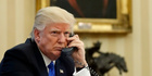 President Donald Trump speaks on the phone with Australian PM Malcolm Turnbull. Photo / AP