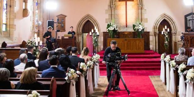 It takes a village to put on a legitimate fake wedding.