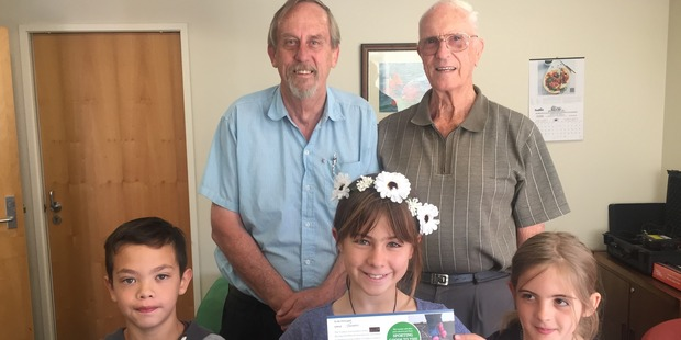 GOME: The Grumpy Old Men's Enterprises Trust has donated a $500 Stirling Sports voucher to Tawhero School plus Stirling Sports have added $75. Pictured are Ed (left) and Jim donating the voucher to Creo, Soffia and Ivy. PICTURE / SUPPLIED