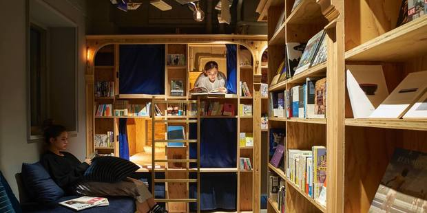 At Book and Bed Tokyo, guests sleep in a closet-sized bunk embedded in rows of bookshelves. Photo / Book and Bed Toyko, Facebook