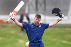 Glenn Phillips celebrates scoring a century for Auckland in the Ford Trophy last month. Photo / photosport.nz
