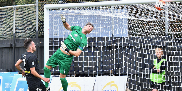Team Wellington's Tom Jackson watches the ball go into the net as Waitakere's keeper Pirmin Strasser fails to make a save. Photo / Photosport