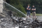 Simon Grace visits the charred remains of his family home in the Port Hills - over 20 years of memories up in smoke