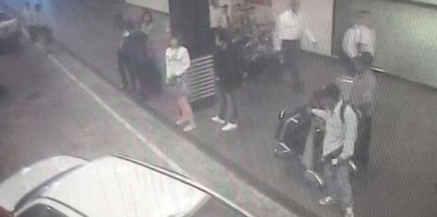 CCTV footage shows a woman (centre, in white) at Kuala Lumpur International Airport, who police say was arrested in connection with the death of Kim Jong-nam. Photo / AP