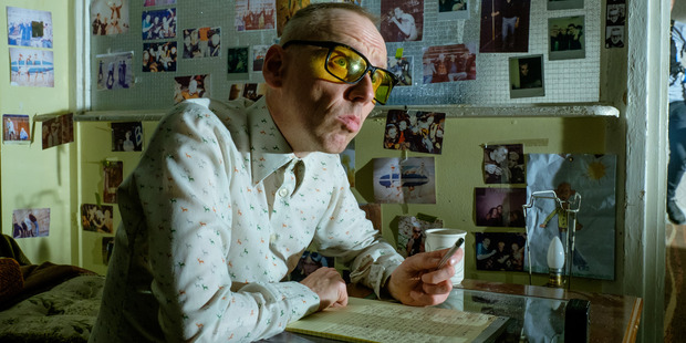 Spud (Ewen Bremner) writing and looking upwards for inspiration in TriStar Pictures' T2: TRAINSPOTTING