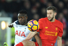 Liverpool's Adam Lallana and Tottenham's Victor Wanyama battle for the ball during their English Premier League clash at Anfield this morning (NZT). Photo / Getty Images.