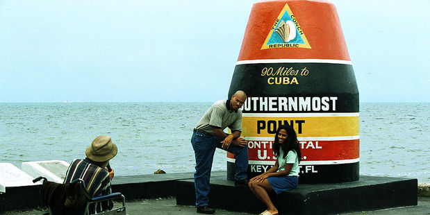 Tourists get their photo taken at The Conch Republic. Photo / Getty Images