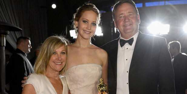 Jennifer Lawrence, winner of Best Actress for her role in 'Silver Linings Playbook' and her parents Karen Lawrence and Gary Lawrence attend the Oscars. Photo / Getty