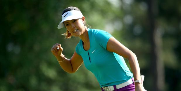 Michelle Wie celebrates a birdie putt during the 69th U.S. Women's Open at Pinehurst. Photo / Getty Images