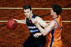 Kirk Penney competes against Cameron Gliddon of the Taipans. Photo / Getty Images