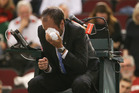 Chair umpire Arnaud Gabas reacts to getting hit in the eye with a ball. Photo / Getty Images.