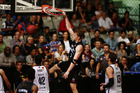 Finn Delany throws down a dunk during the Breakers' win over Melbourne on Friday. Photo / Getty