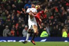 Zlatan Ibrahimovic of Manchester United and Younes Kaboul of Watford compete for the ball during their Premier League match. Photo/Getty Images