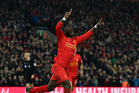Sadio Mane of Liverpool celebrates after scoring the opening goal during the Premier League match between Liverpool and Tottenham Hotspur at Anfield this morning (NZT). Photo / Getty Images.