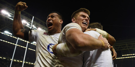 Elliot Daly of England is congratulated by teammates Nathan Hughes (L) and Owen Farrell (C) after scoring the match winning try during their win against Wales this morning (NZT). Photo / Getty Images.