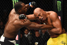 Derek Brunson punches Anderson Silva of Brazil in their middleweight bout during UFC 208. Photo/Getty Images