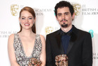 Emma Stone, winner of the Best Actress Award for 'La La Land', and Damien Chazelle, winner of Best Director for 'La La Land', pose in the winners room at the BAFTAs. Photo / Getty