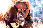 Recording artists James Hetfield (L) of music group Metallica and Lady Gaga perform onstage during The 59th GRAMMY Awards. Photo / Getty
