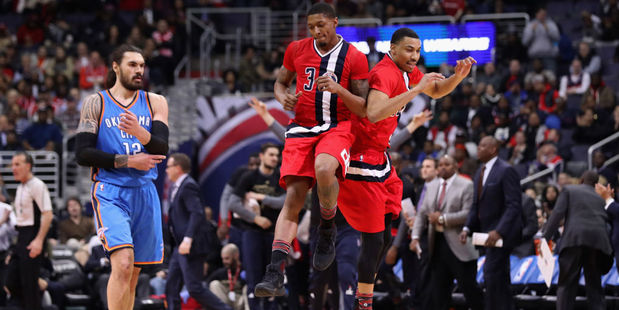 Bradley Beal and Otto Porter Jr. of the Washington Wizards celebrate in front of Steven Adams. Photo / Getty