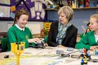 British Prime Minister Theresa May looked less than impressed by children at a school in Copeland. Photo / Getty