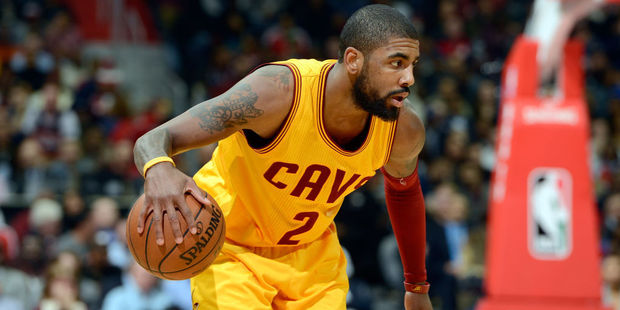 Kyrie Irving with a basketball, which he probably believes is flat. Photo / Getty