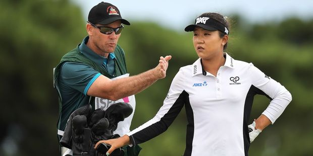 Lydia Ko of New Zealand chats with her caddie Gary Matthews. Photo / Getty