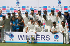 Members of Indian team pose with the winning trophy after their win over Bangladesh in their one-off cricket test match in Hyderabad. Photo / AP