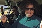 Oprah Winfrey and Mindy Kaling fly in a helicopter over the set of their new movie being filmed in Queenstown. Oprah posted the video to her 8.3 million Instagram followers.