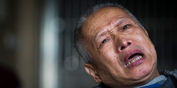 "Loading Bo Tu cries over the death of his daughter in his Wuhan home. ""Not a single day has been spent without pain and sorrow,"" he says. Photo by Mike Scott"