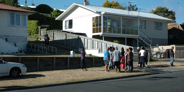 People gathered at an address on Terence St in Taupo after a person was killed on the driveway in the early hours of the morning. Photo / Laurilee McMichael