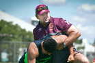 INSPIRING: Former Brisbane Broncos and Queensland star Michael Hancock shows how to tackle at Sunday's coaching session. PHOTO: ANDREW WARNER